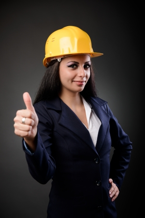 Youn construction engineer woman with hardhat making thumbs up sign Stock Photo - 16519521