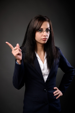 Hispanic young teacher admonishing, pointing the finger photo