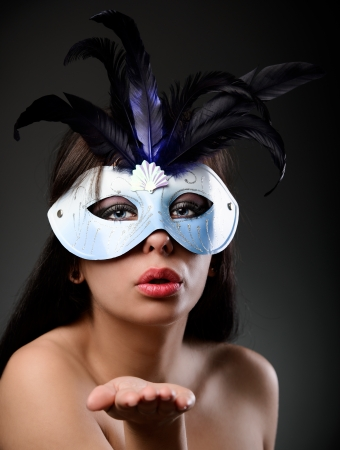 Closeup portrait of a beautiful topless latin woman wearing a feathered mask Stock Photo - 16519533