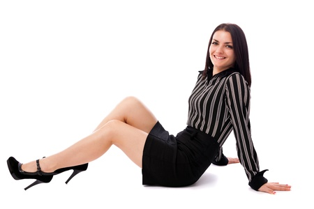 Full length portrait of a young businesswoman sitting on the floor isolated on white background Stock Photo - 16663391