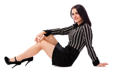 businesswoman skirt: Full length portrait of a young businesswoman sitting on the floor isolated on white background Stock Photo
