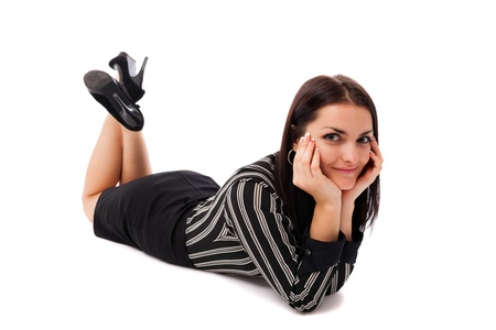 Full length portrait of a happy businesswoman lying on the floor isolated on white background Stock Photo - 16663393