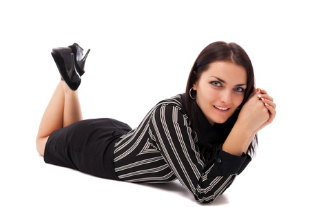 Full length portrait of a happy businesswoman lying on the floor isolated on white background Stock Photo - 16663399