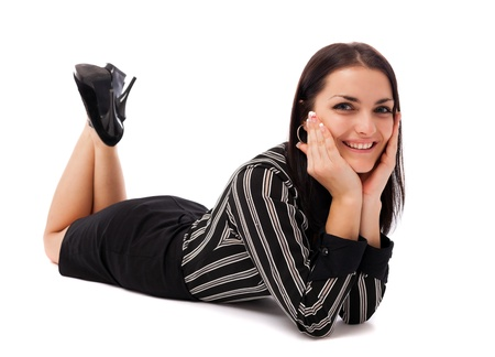 Full length portrait of a happy businesswoman lying on the floor isolated on white background Stock Photo - 16663418