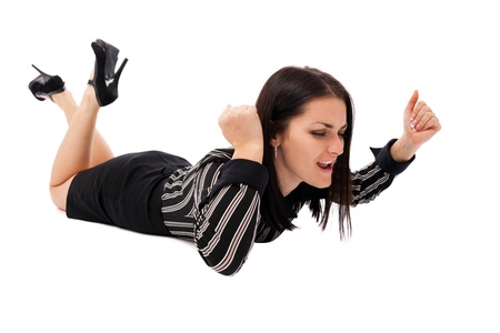 Full length portrait of an angry businesswoman hitting the floor with fists isolated on white background photo