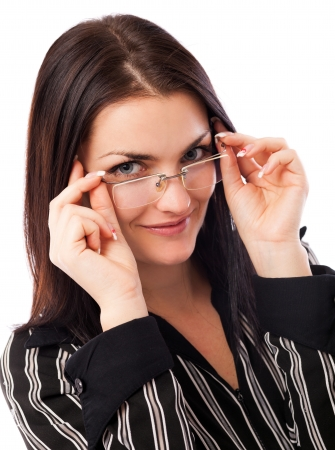 Closeup portrait of a beautiful young businesswoman looking over her glasses isolated on white background Stock Photo - 16663434