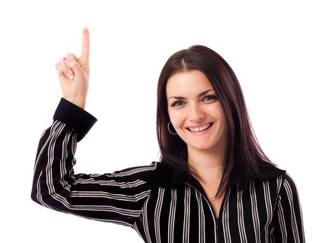 Closeup portrait of a young businesswoman pointing up at copyspace isolated on white background Stock Photo - 16663422