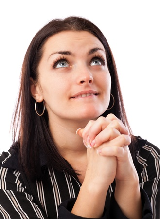 Closeup portrait of a young businesswoman praying while looking up Stock Photo - 16663433