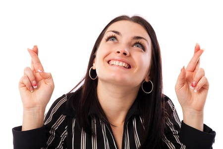 Closeup portrait of a young businesswoman showing crossed fingers making wish Stock Photo - 16663380