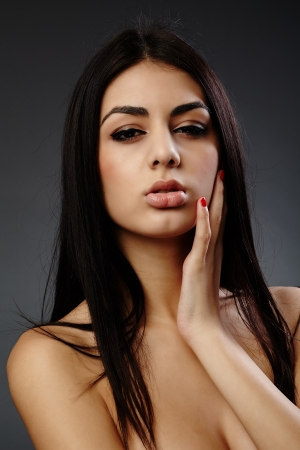 Glamour studio closeup portrait of an alluring young hispanic woman on gray background Stock Photo - 16891155