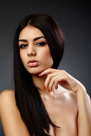 Glamour studio closeup portrait of an alluring young hispanic woman on gray background Stock Photo - 16891158
