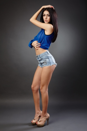 Studio full length portrait of a gorgeous latin young woman photo