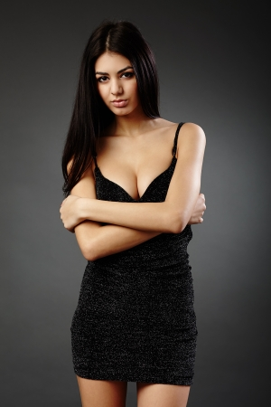 Studio glamour shot of a beautiful hispanic woman in black dress Stock Photo - 16891120
