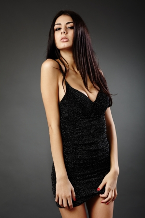 Studio glamour shot of a beautiful latin woman in black dress Stock Photo - 16891148