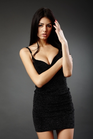 Studio glamour shot of a beautiful hispanic woman in black dress Stock Photo - 16891165