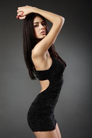 Studio glamour shot of a beautiful hispanic woman in black dress Stock Photo - 16891164