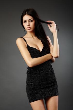 Studio glamour shot of a beautiful hispanic woman in black dress Stock Photo - 16891147