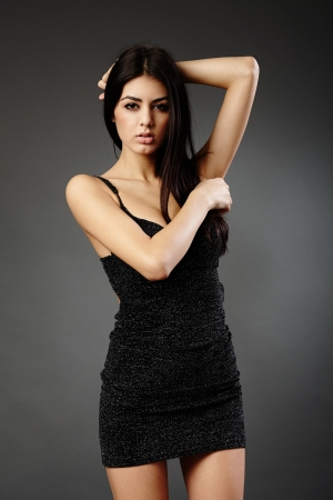 Studio glamour shot of a beautiful latin woman in black dress Stock Photo - 16891153