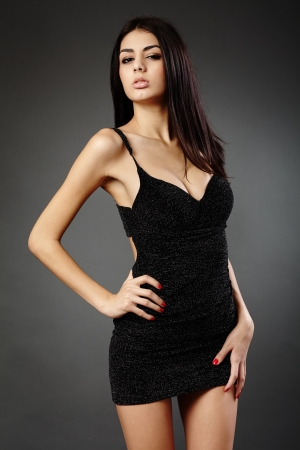 Studio glamour shot of a beautiful latin woman in black dress Stock Photo - 16891166