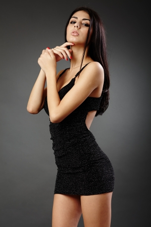 Studio glamour shot of a beautiful hispanic woman in black dress Stock Photo - 16891163