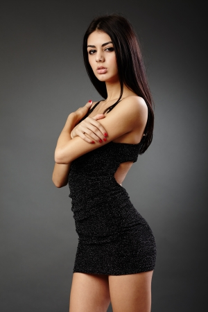 Studio glamour shot of a beautiful hispanic woman in black dress Stock Photo - 16891161