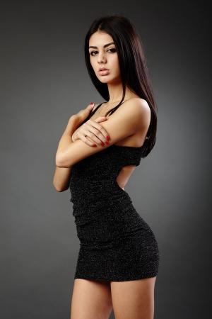 Studio glamour shot of a beautiful hispanic woman in black dress Stock Photo - 16891161
