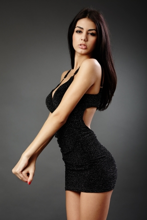 Studio glamour shot of a beautiful hispanic woman in black dress Stock Photo - 16891162