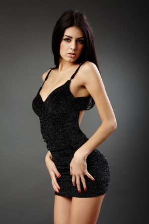 Studio glamour shot of a beautiful hispanic woman in black dress Stock Photo - 16891117