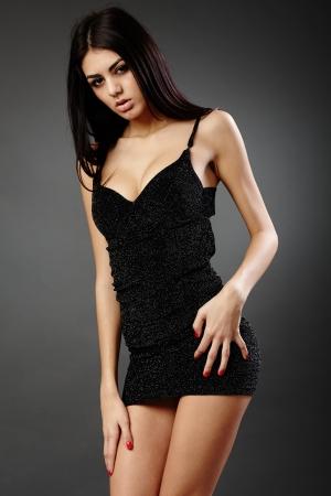 Studio glamour shot of a beautiful hispanic woman in black dress Stock Photo - 16891136