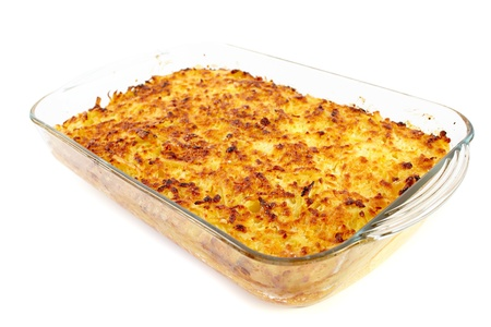 Baked crusty macaroni with cheese isolated on white background photo
