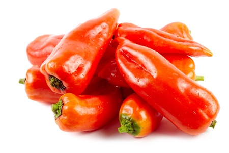 Pile of fresh raw red bell peppers isolated on white background Stock Photo - 17180187
