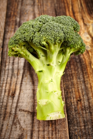 Closeup of a broccoli on a rustic wooden board Stock Photo - 17324650