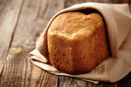 Homemade bread in a towel on a wooden board Stock Photo - 17324639
