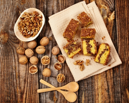 Cookies with walnut and cocoa filling on a wooden board Stock Photo - 17324681