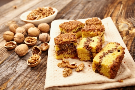Cookies with walnut and cocoa filling on a wooden board Stock Photo - 17324675