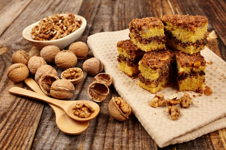 Cookies with walnut and cocoa filling on a wooden board Stock Photo - 17324685