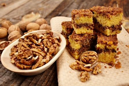 Cookies with walnut and cocoa filling on a wooden board Stock Photo - 17324678
