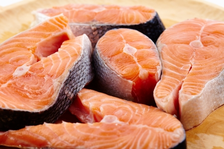Closeup of raw red salmon slices ready to be prepared Stock Photo - 17324641