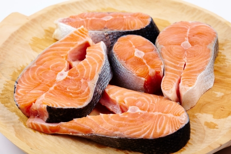Closeup of raw red salmon slices ready to be prepared Stock Photo - 17324645