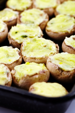 Mushrooms stuffed with cheddar cheese and herbs photo