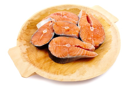 Salmon slices on a wooden board isolated on white background Stock Photo - 17324562