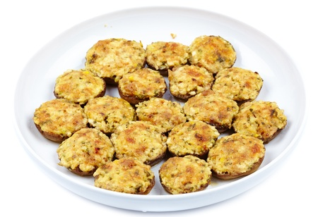 Stuffed mushrooms on a plate isolated on white background Stock Photo - 17324570