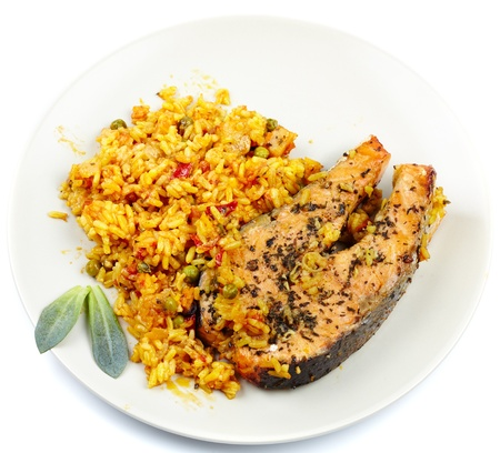 Red salmon garnished with rice, peas and other vegetables on a plate Stock Photo - 17324557