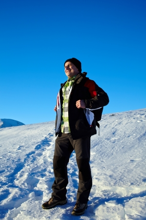 Full length portrait of a man in an winter landscape Stock Photo - 17334655