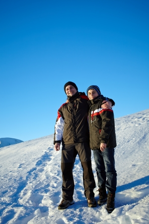 Happy father and son outdoor on the mountain in winter holiday Stock Photo - 17324646