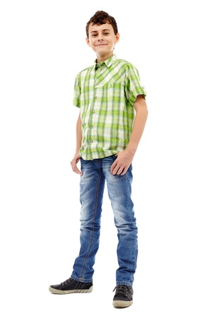 Full length studio portrait of a teen boy in green plaid shirt