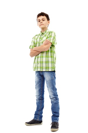 Full length studio portrait of a teen boy in green plaid shirt with arms folded photo