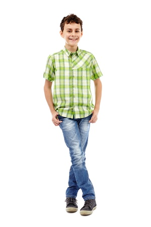 Full length studio portrait of a teen boy in green plaid shirt with hands in his pockets photo