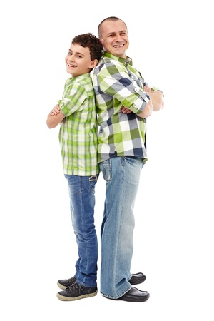 Father and son standing back to back isolated on white background