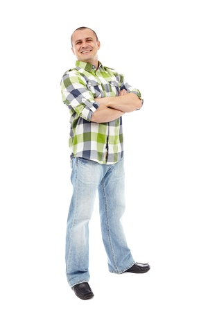 Casual man standing with his arms folded isolated on white background photo